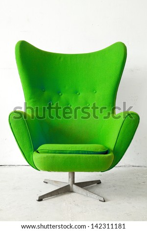 Green modern style Armchair in vintage room - stock photo