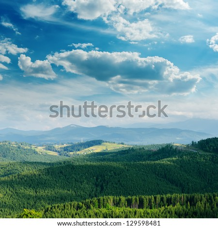green mountain covered by cloudy sky. Bukovel region, Ukraine - stock photo
