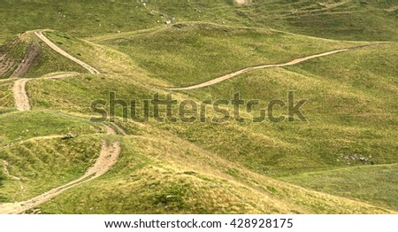 green mountain plateau with road