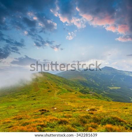 green mountain ridge before a dawn - stock photo