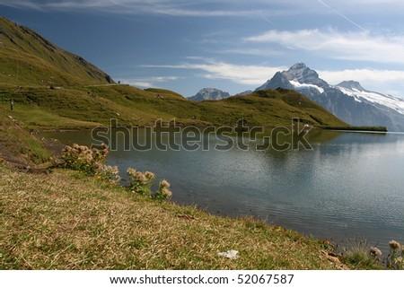 Green mountain with blue lake - stock photo