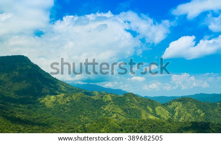 Green mountain with blue sky and clouds background - stock photo