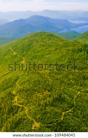 Green mountain with trails - stock photo