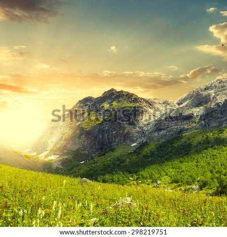 green mountains at the sunset - stock photo