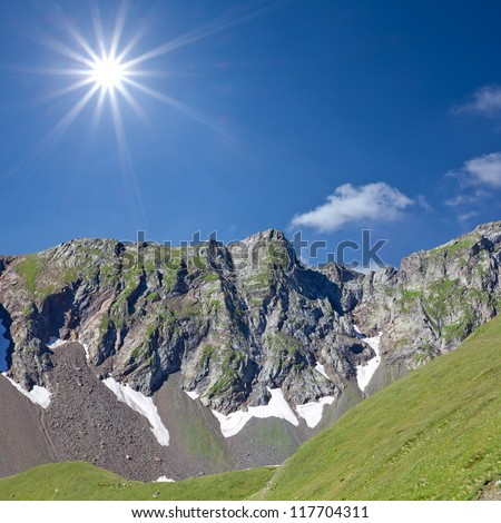 green mountains by a sunny day - stock photo