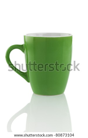 Green mug isolated on a white background, with reflections.