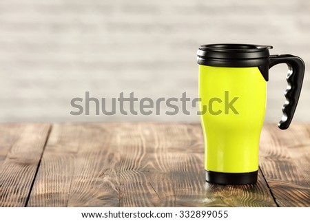 green mug wooden table place wall and space for you  - stock photo