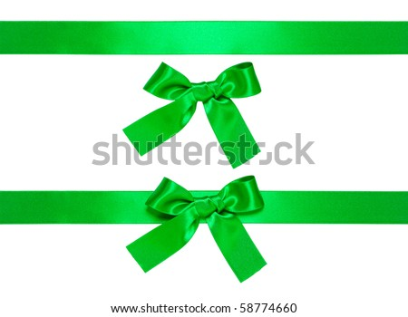 green multiple ribbons with bow isolated on white - stock photo