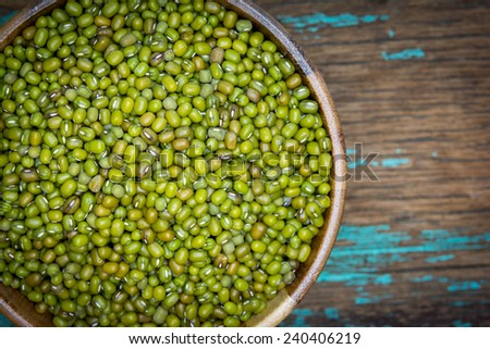 Green mung beans in bowl on the table   - stock photo