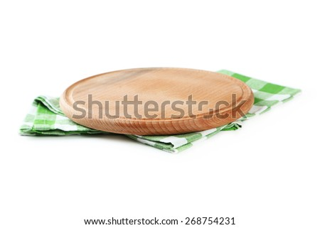 Green napkin and cutting board isolated on white - stock photo
