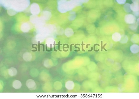 Green nature bokeh on canvas background, pastel background - stock photo