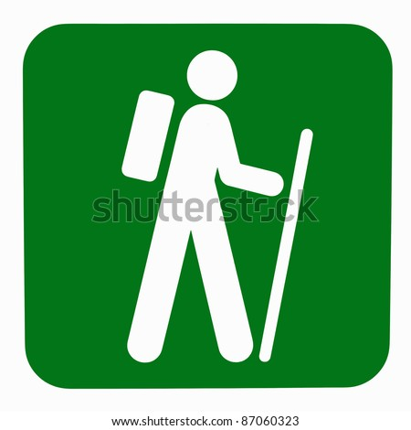 Green nature walk sign with white person figure holding a cane and wearing a backpack - stock photo