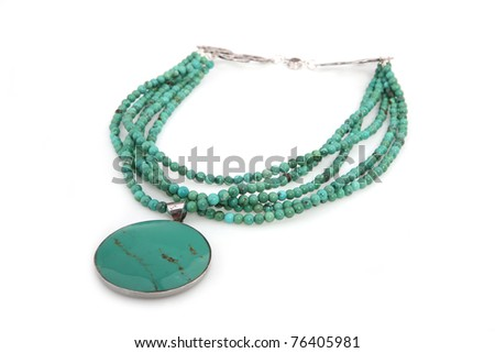 Green necklace isolated on white - stock photo