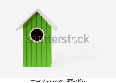 green nest box birdhouse house for birds isolated on white background with shadow - stock photo