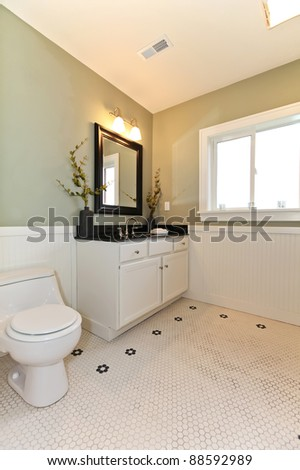 Green new classic green bathroom with white ceramic tiles.