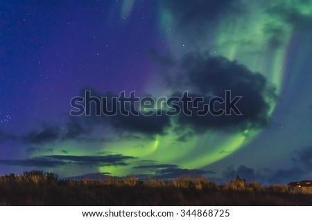 green northern lights in the sky - stock photo