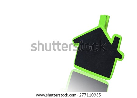Green note board with home shape on isolated white background