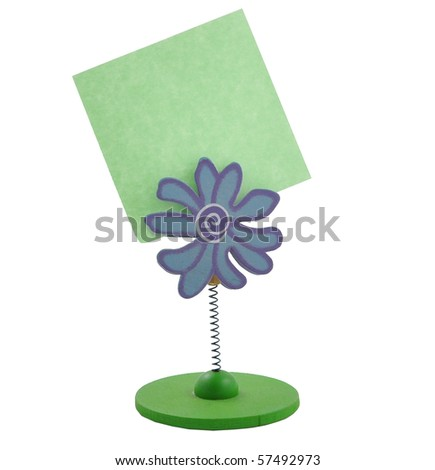 Green note paper on white background holder flowers - stock photo