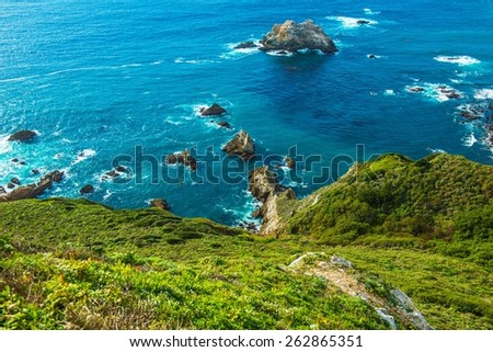 Green Ocean Shore Coastal California, United States. Pacific Ocean Shore. - stock photo