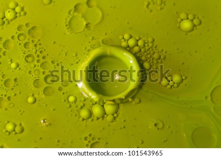 "Green oil ""crater"" after the collision - stock photo"
