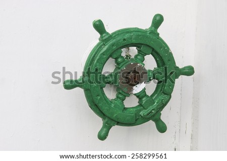 Green old rudder - stock photo