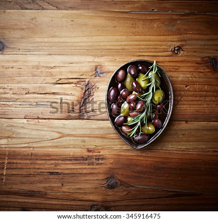 Green olives and black olives (Aragon Black Olives) in olive oil  - stock photo
