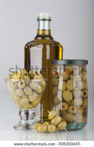 green olives and oil on white background