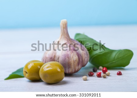 Green olives, basil, garlic and oil - stock photo