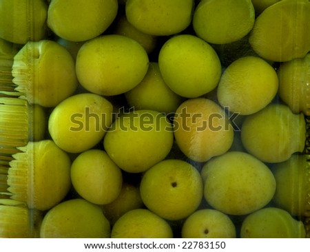 Green olives in a jar up close. - stock photo