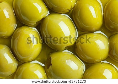 green olives in olive oil - stock photo