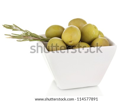 Green olives in white bowl with rosemary isolated on white - stock photo