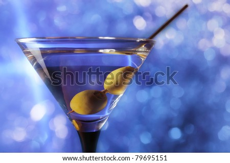 green olives in wineglass,focus on a olives - stock photo