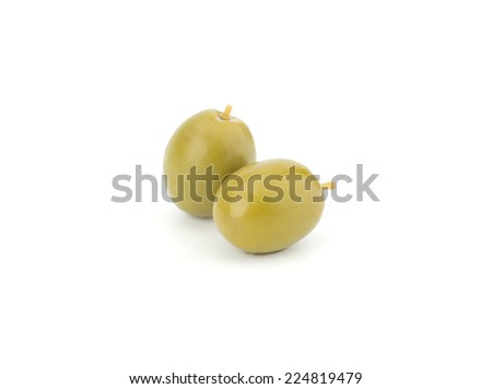 Green olives isolated on white background closeup