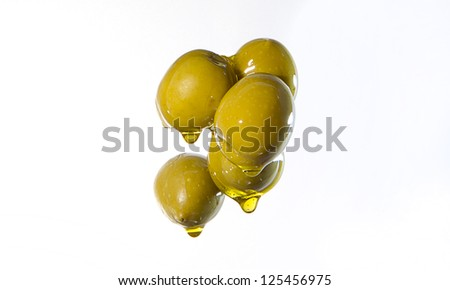 green olives of the oil gushing - stock photo
