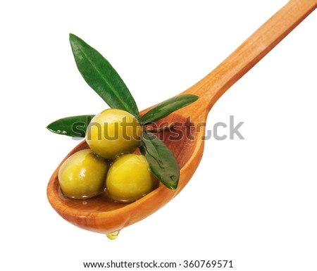 Green olives on a wooden spoon. Isolated on white background - stock photo