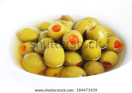 green olives stuffed with pepper in bowl - stock photo