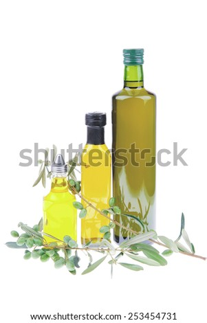 green olives with gold oil over white - stock photo
