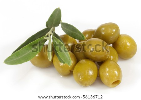 Green olives with olive branch on white background - stock photo