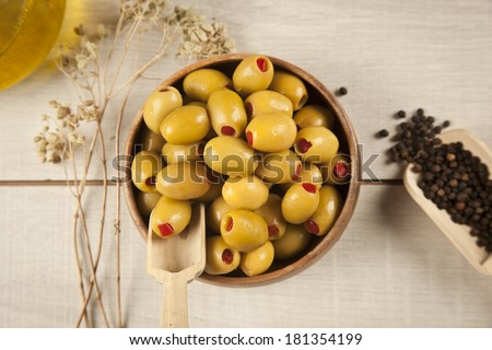 Green olives with olive oi - stock photo