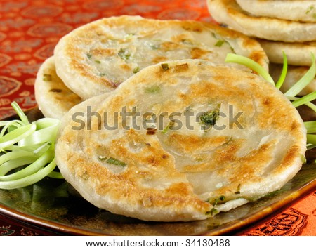 Green onion pancakes are a fried Chinese flatbread eaten as a snack or with a meal. - stock photo