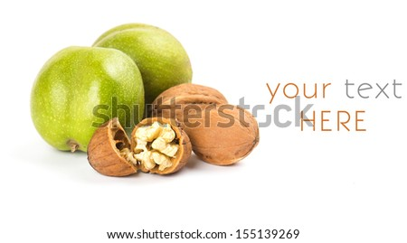 green open walnuts closeup on white background - stock photo