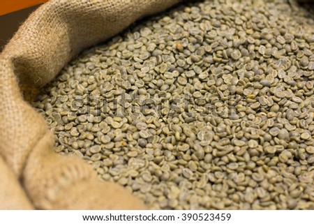 green organic coffee beans in a sack