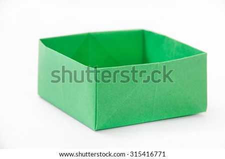 Green origami box on the white background.