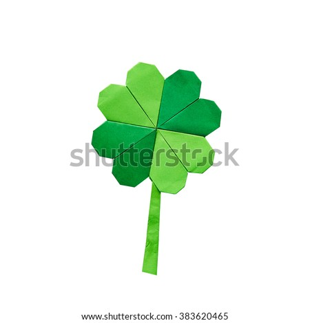 Green origami paper shamrock clover leaf on white background isolated. St. Patrick's Day greeting postcard template. Space for copy, text, lettering. - stock photo