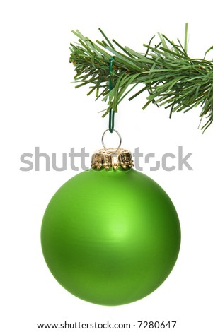 green ornament hanging on a pine tree branch - stock photo