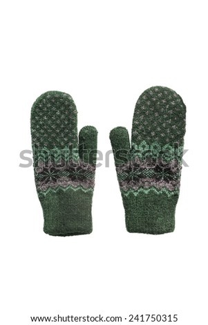 Green ornamental knitted mittens on white background - stock photo