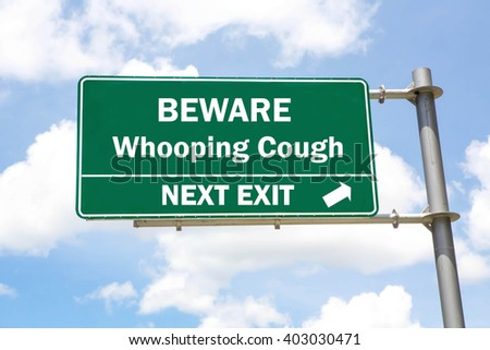 Green overhead road sign with a Beware of Whooping Cough Next Exit concept against a partly cloudy sky background. - stock photo