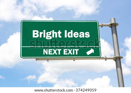 Green overhead road sign with a Bright Ideas Next Exit concept against a partly cloudy sky background. - stock photo