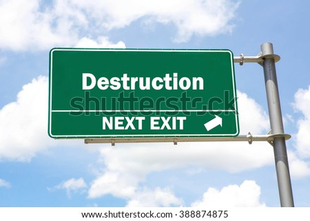Green overhead road sign with a Destruction Next Exit concept against a partly cloudy sky background. - stock photo