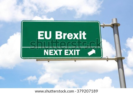 Green overhead road sign with a  EU Brexit Next Exit concept against a partly cloudy sky background. - stock photo